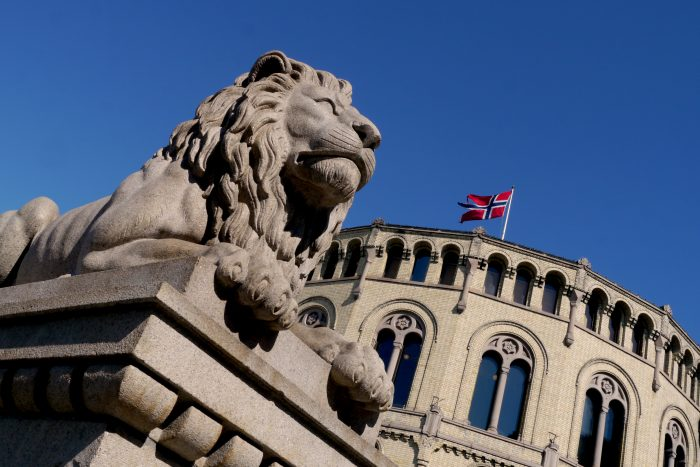 norwegian parliament building in oslo, with famous lion statue